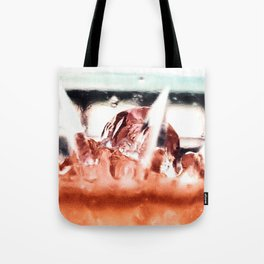 melting ice in a glass Tote Bag