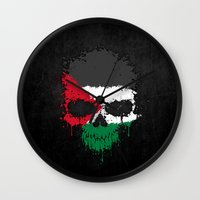 palestine Wall Clocks featuring Flag of Palestine on a Chaotic Splatter Skull by Jeff Bartels