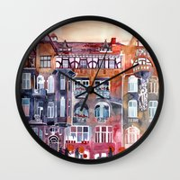 takmaj Wall Clocks featuring Apartment House in Poznan and orange umbrellas by takmaj
