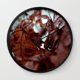 Leaves by the river Wall Clock