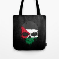 palestine Tote Bags featuring Flag of Palestine on a Chaotic Splatter Skull by Jeff Bartels