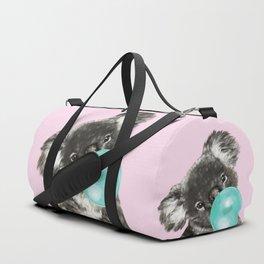 Playful Koala Bear with Bubble Gum in Pink Duffle Bag