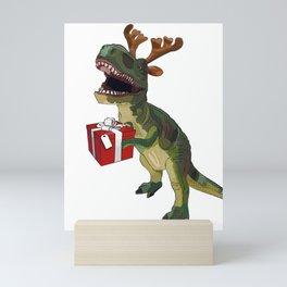 Christmas Trex holding present Mini Art Print