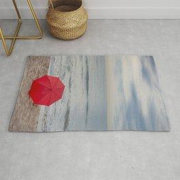 Red Umbrella lying at the beach III Rug