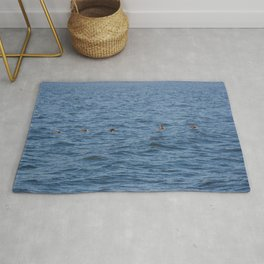 Lucky fishers-puffins Rug
