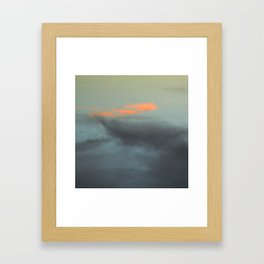 Three orange clouds Framed Art Print