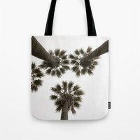 palm trees Tote Bags featuring palm trees by Joao Bizarro