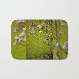 Vibrant pink Magnolia blossoms Bath Mat