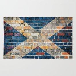 Scotland flag on a brick wall Rug