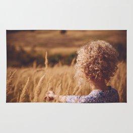 Girl in the field Rug