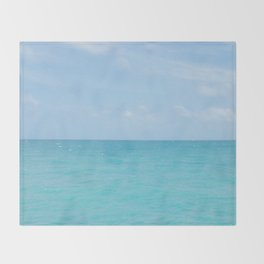 Above the sea Throw Blanket