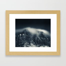 Darkness and white clouds over the mountains Framed Art Print