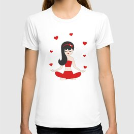 cute young girl practices yoga in the lotus position T-shirt