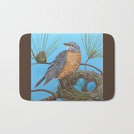 Robin with nest in Georgia pine tree Bath Mat