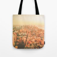 new york city Tote Bags featuring New York City Sunset by Vivienne Gucwa