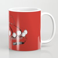 mini cooper Mugs featuring The Italian Job Red Mini Cooper by Martin Lucas