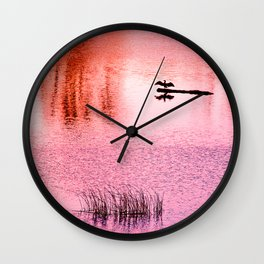 Ripples, reed, reflections,red Wall Clock