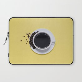 Black Cup of Coffee with Coffee Beans on Yellow Laptop Sleeve