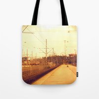 finland Tote Bags featuring helsinki (finland) - railway station by aune