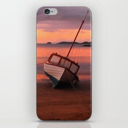 Beached yacht iPhone Skin