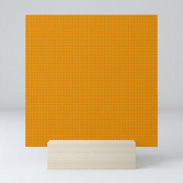 Rivet dots on orange Mini Art Print