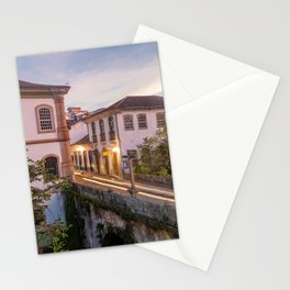 Beautiful landscape of colonial style buildings and old bridge in a cloudy sunset Stationery Cards