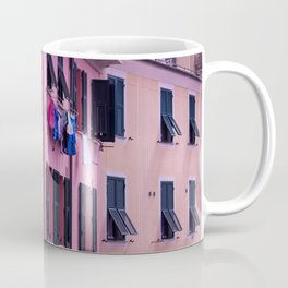 Tuscan building with its typical windows and balconies with clothes drying in the sun Coffee Mug
