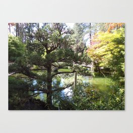 Peaceful Pond in Japanese Garden with Trees and a Bridge Canvas Print