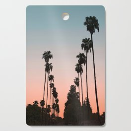 California Sunset // Palm Tree Silhouette Street View Orange and Blue Color Sky Beach Photography Cutting Board