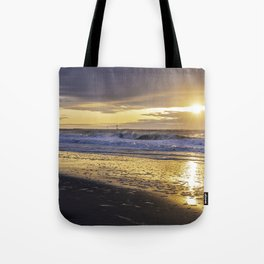 Dramatic sunrise over Jersey Shore Tote Bag
