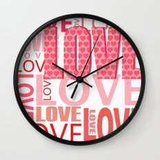 The Word Love In Red With Hearts Wall Clock