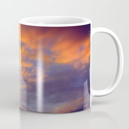 Dramatic colorful warm orange climactic atmosphere sunset clouds in a blue sky Coffee Mug