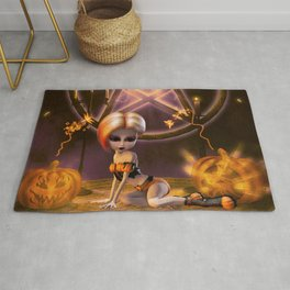 Cute little girl in the night with pumpkin Rug