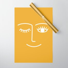 wink / mustard Wrapping Paper