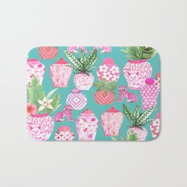 Pink Chinese ginger jars on teal with calathea plants and palms Bath Mat