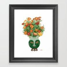 Marigolds in cat face vase  Framed Art Print