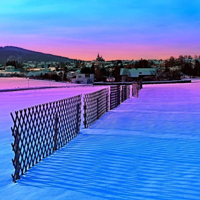 Fences on a winter sundown Comforters