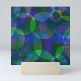 Abstract soap made of cosmic transparent blue circles and green bubbles on a languid background. Mini Art Print