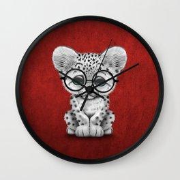 Cute Snow Leopard Cub Wearing Glasses on Deep Red Wall Clock