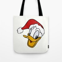 donald duck Tote Bags featuring Christmas Donald Duck by Yuliya L