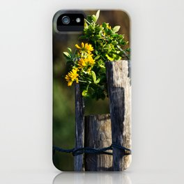 Yellow flower and wood fence iPhone Case