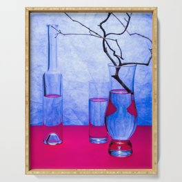 Still life with glass objects on a blue background Serving Tray