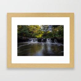 Waterfall in the morning sun Framed Art Print