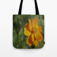 rileigh smirl Tote Bags featuring Orange Flower by Rileigh Smirl