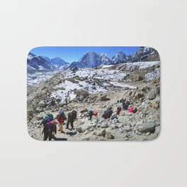 Trekking in Himalaya. Group of hikers  with backpacks   on the trek in Himalayas, trip  to the base  Bath Mat