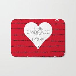 The embrace of love Bath Mat
