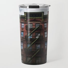 Rich red brick buildings with green fire escape stairs in Chinatown, New York City Travel Mug