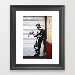 Banksy, Man with flowers Framed Art Print