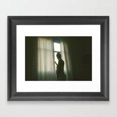girl in morning window light Framed Art Print