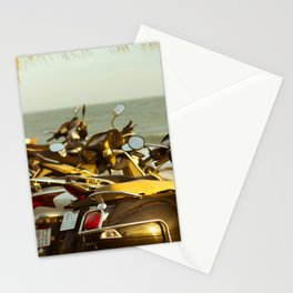 Scooters parked on parking with sea bay on the city beach Stationery Cards